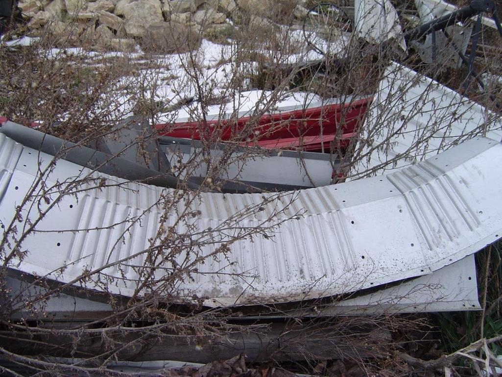 scrap-metal-pile-outside-open-shed