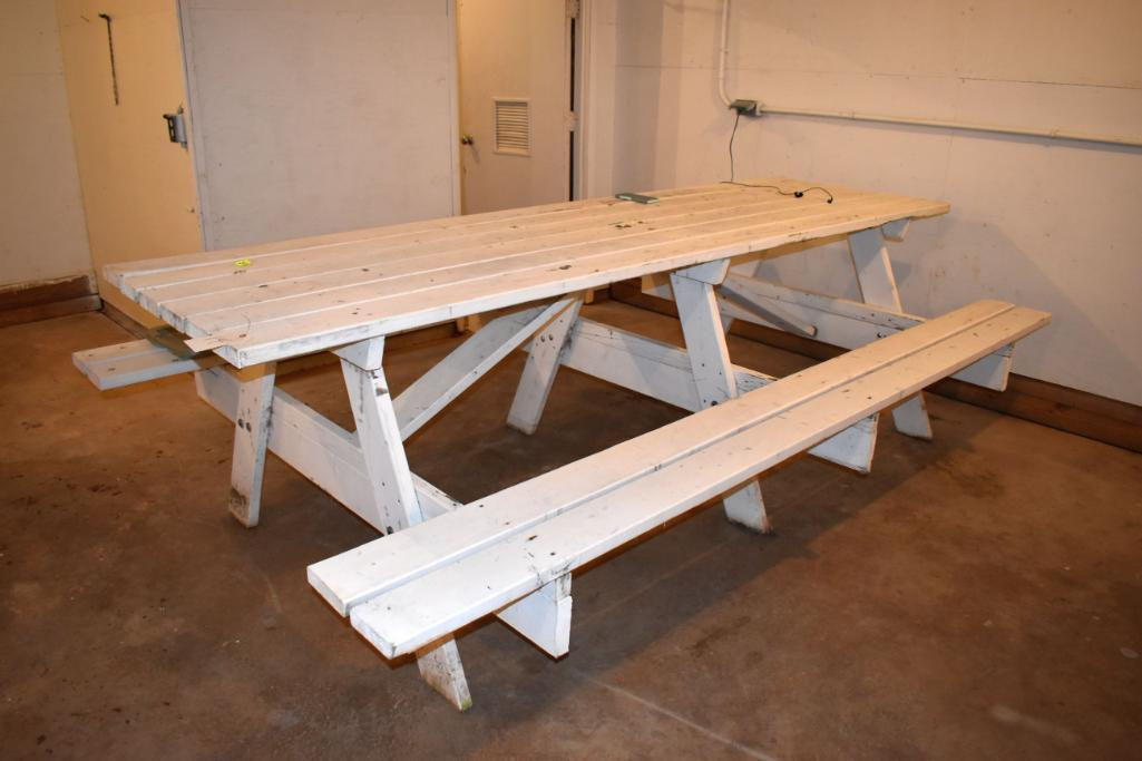 10-wooden-picnic-table-located-building-1