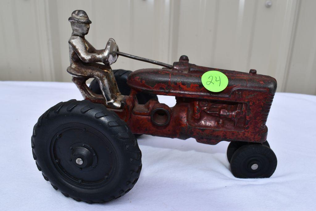 arcade-farmall-m-tractor-with-man-casting-is-busted-on-rear-hood