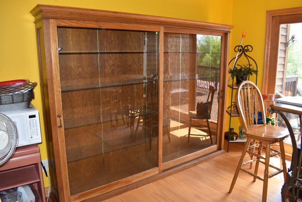 oak-double-sliding-door-store-cabinet-one-piece-glass-shelves-96-long-73-tall-16-wide