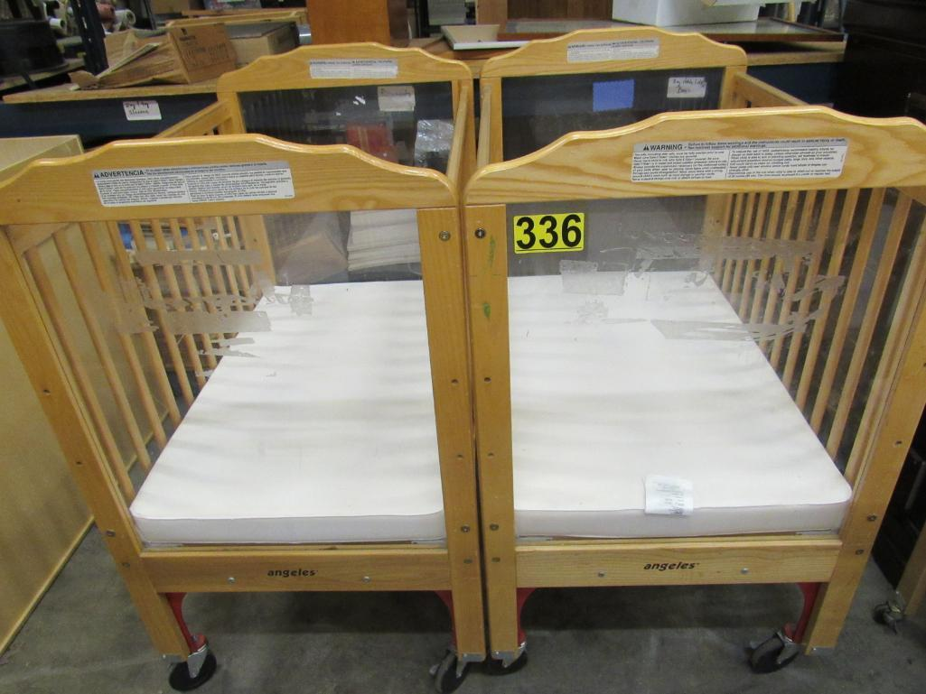 lot-of-2-cribs-on-wheels