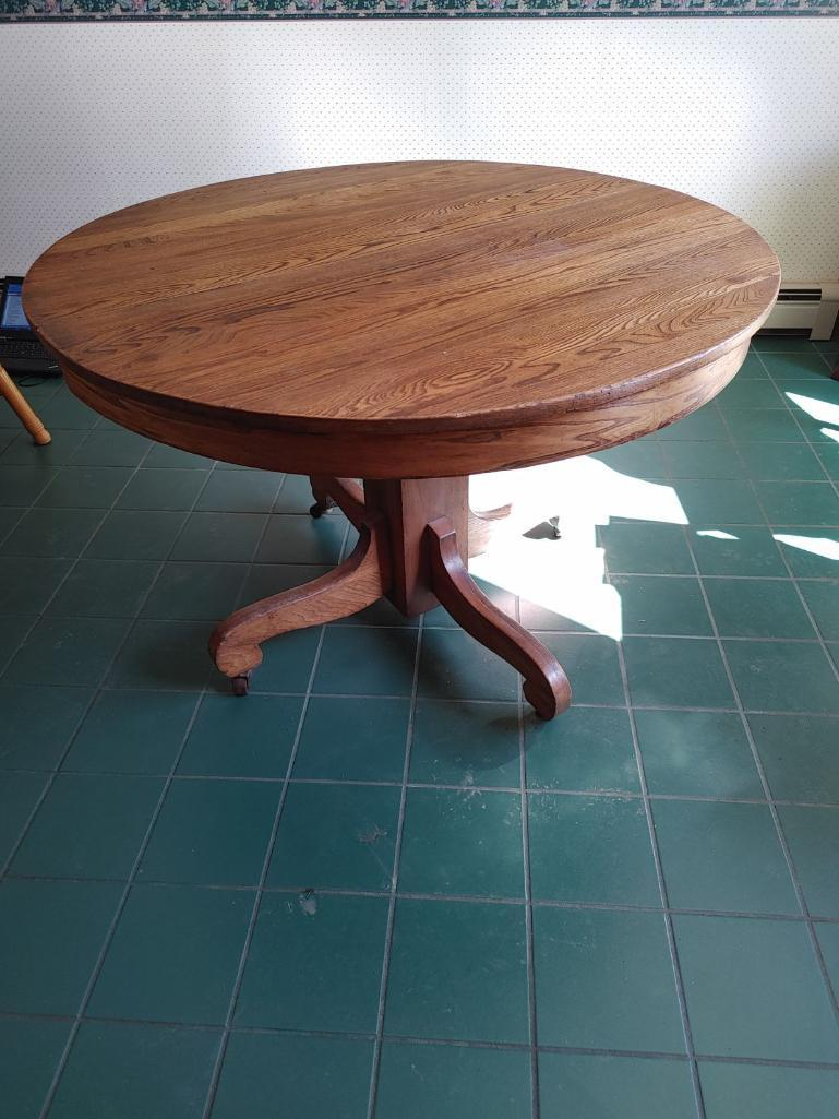 round-oak-dining-table