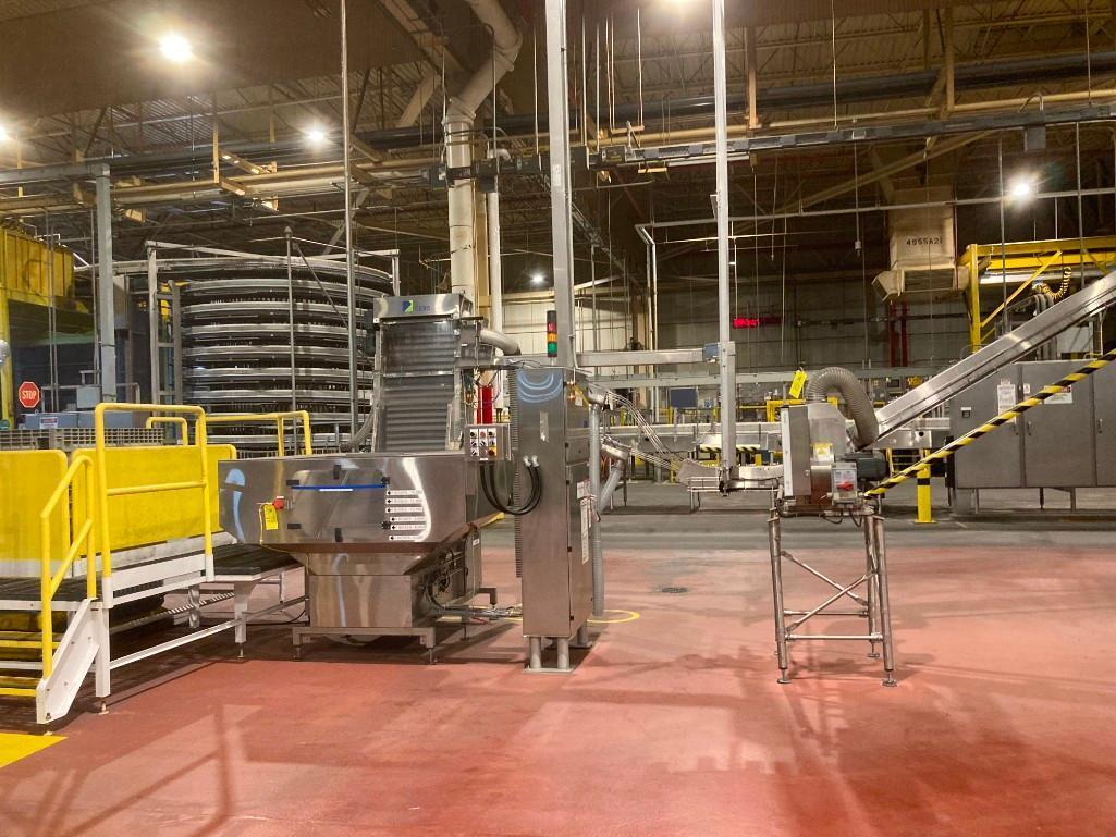 pet-line-gebo-cap-feed-system-with-conveyor-and-blower-units-to-filler-with-mezzanine-platform