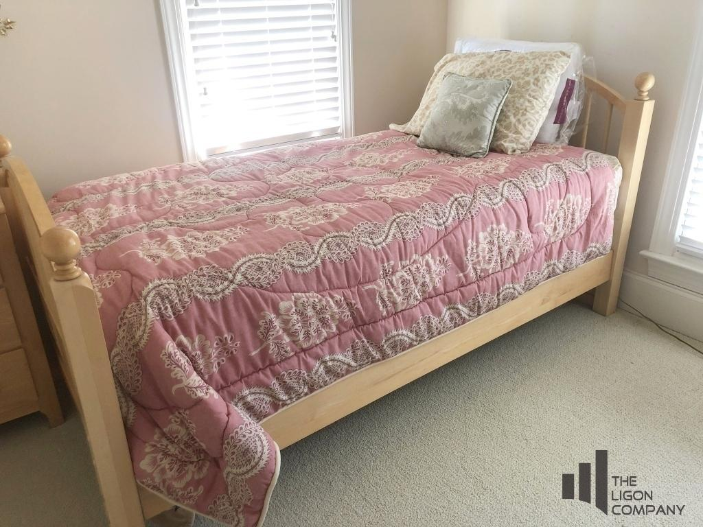 twin-bed-with-bedding