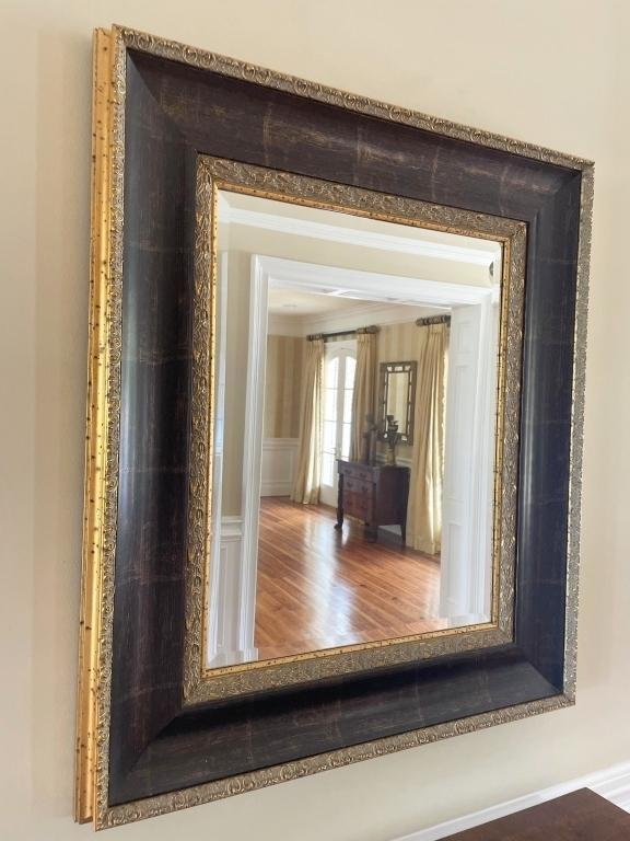 beveled-mirror-in-ornate-black-and-gold-toned